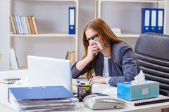 The businesswoman employee sick in the office. Businesswoman employee sick in the office Stock Photos