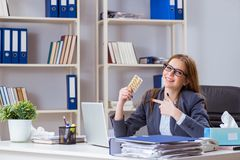 The businesswoman employee sick in the office. Businesswoman employee sick in the office Royalty Free Stock Photography