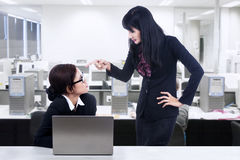 Businesswoman and employment issues. Businesswoman angry at her subordinate Royalty Free Stock Photos