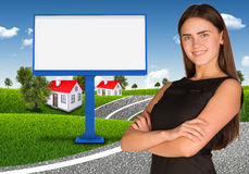 Businesswoman with empty billboard, trees and Royalty Free Stock Photo
