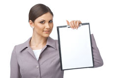 Businesswoman with empty clipboard. Businesswoman holding an empty clipboard over white background Royalty Free Stock Photos