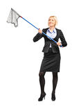 Businesswoman with an empty fishing net Royalty Free Stock Photography