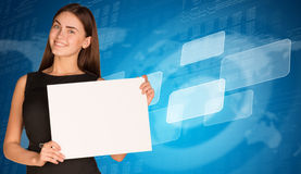 Businesswoman with empty frames and world map Royalty Free Stock Images