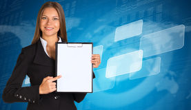Businesswoman with empty frames and world map Stock Photo