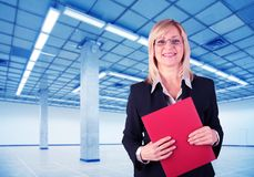 Businesswoman and Empty hall with columns Stock Photo