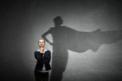Businesswoman in empty room . Mixed media Royalty Free Stock Images
