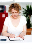 Businesswoman engrossed in her work Stock Image