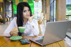 Businesswoman enjoy coffee at cafe Stock Photo