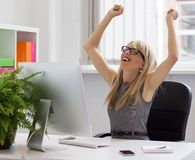 Businesswoman enjoying success at work Stock Photos