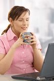 Businesswoman enjoying tea at desk Royalty Free Stock Images