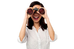 Businesswoman enjoying view through binoculars Stock Photo