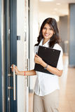 Businesswoman entering office Stock Photo