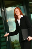 Businesswoman Entering Office royalty free stock photos