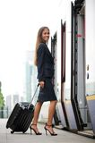 Businesswoman entering train with suitcase Royalty Free Stock Photos
