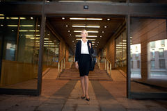 Businesswoman by Entrance Stock Image