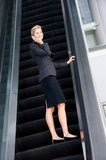 Businesswoman On Escalator Royalty Free Stock Photography