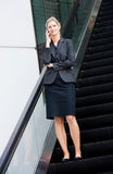 Businesswoman On Escalator Stock Image