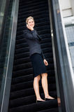 Businesswoman On Escalator Royalty Free Stock Photo