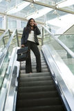 Businesswoman on an Escalator Stock Photo