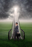Businesswoman with escalator on the meadow Stock Photography