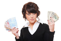 Businesswoman with euro and dollar money notes. Isolated on white background stock photo