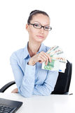 Businesswoman  with euros in hand Stock Images