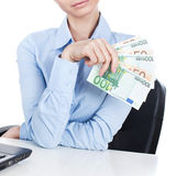 Businesswoman  with euros in hand Royalty Free Stock Image