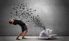 Businesswoman evades splash ideas Stock Photo