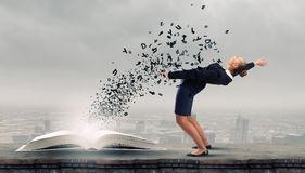 Businesswoman evades splash ideas Royalty Free Stock Photo