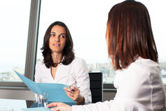 Businesswoman evaluating the performance of a worker Royalty Free Stock Image