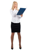 Businesswoman examining documents Royalty Free Stock Photos
