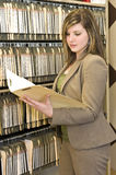 Businesswoman Examining A File Royalty Free Stock Photo