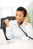 Businesswoman exciting news. Happy businesswoman receiving exciting news over the phone Royalty Free Stock Photography