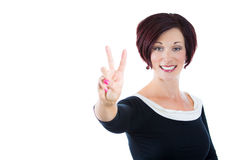 businesswoman, executive, successful woman in a black dress, showing a victory sign Stock Images