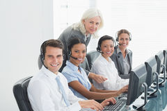 Businesswoman with executives using computers Stock Photos