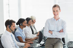 Businesswoman with executives using computers Royalty Free Stock Images