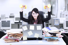 Businesswoman exercise in office Stock Images