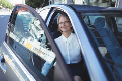 Businesswoman exiting car Stock Image