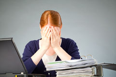 Businesswoman Experiencing Stress at Work Royalty Free Stock Photos