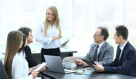 Businesswoman explaining business plan to her colleagues. Photo with place for text royalty free stock photography