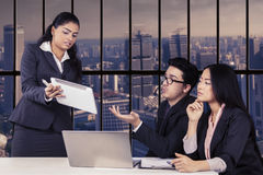 Businesswoman explaining document with tablet Stock Photography