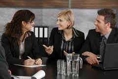 Businesswoman explaining on meeting Stock Image