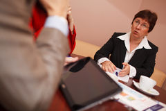 Businesswoman explaining something in a meeting Stock Photo