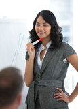 Businesswoman explaining the stock market Stock Image