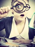 Businesswoman explore documents with big loupe. Exploration and work education. Focus secretary accountant businesswoman explore documents with big loupe. Woman stock images