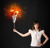 Businesswoman with an explosion bulb Royalty Free Stock Photos