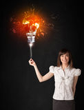 Businesswoman with an explosion bulb Royalty Free Stock Images