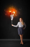 Businesswoman with an explosion bulb Stock Images