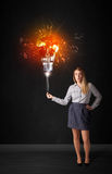 Businesswoman with an explosion bulb Royalty Free Stock Image