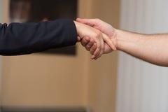 Businesswoman Extending Hand To Shake Stock Photo